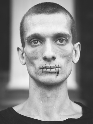 "July 22, 2012. ""Seam"" is the first action of Peter Pavlensky: he sews his mouth in support of the punk band Pussy Riot members."